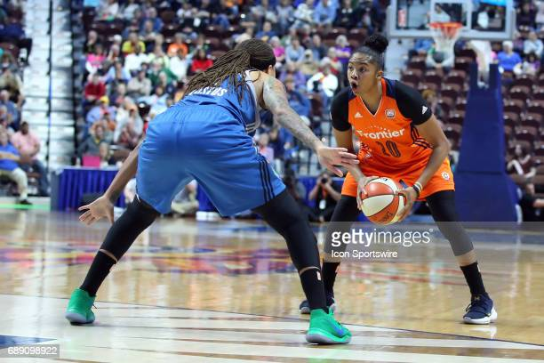 Connecticut Sun guard Alex Bentley defended by Minnesota Lynx guard Seimone Augustus during the first half of an WNBA game between Minnesota Lynx and...