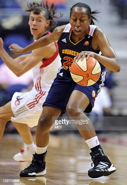 Connecticut Sun guard Allison Hightower works her dribble against Washington Mystics guard Kelly Miller left during the fourth quarter at the Verizon...