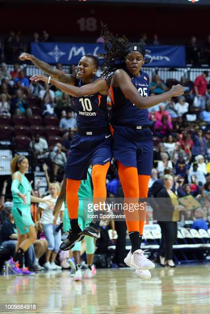 Connecticut Sun guard Courtney Williams and Connecticut Sun forward Jonquel Jones celebrate during a WNBA game between New York Liberty and...