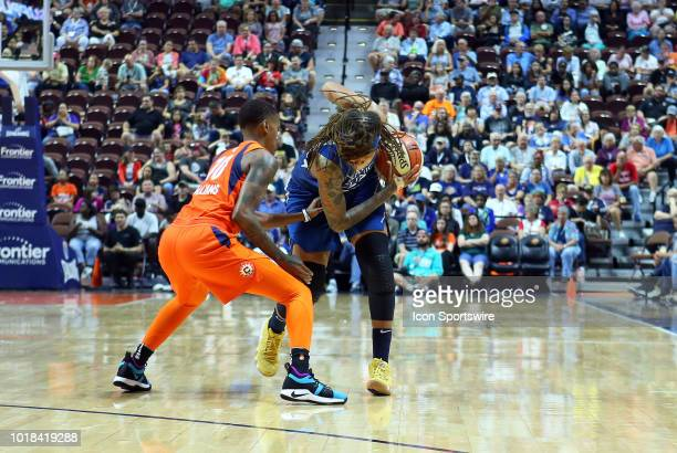 Connecticut Sun guard Courtney Williams defends Minnesota Lynx guard Seimone Augustus during a WNBA game between Minnesota Lynx and Connecticut Sun...