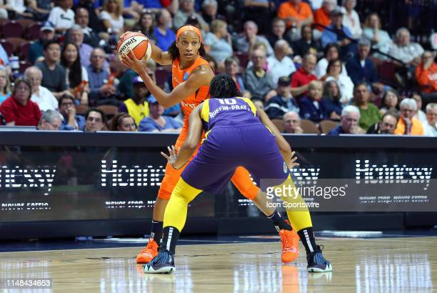 Connecticut Sun guard Jasmine Thomas defended by Los Angeles Sparks guard Tierra RuffinPratt during a WNBA game between Los Angeles Sparks and...
