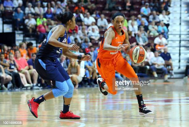 Connecticut Sun guard Jasmine Thomas drives to the basket against Atlanta Dream guard Renee Montgomery during a WNBA game between Atlanta Dream and...