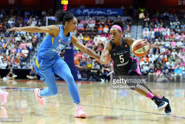 Connecticut Sun guard Jasmine Thomas drives to the basket against Chicago Sky forward Gabby Williams during a WNBA game between Chicago Sky and...