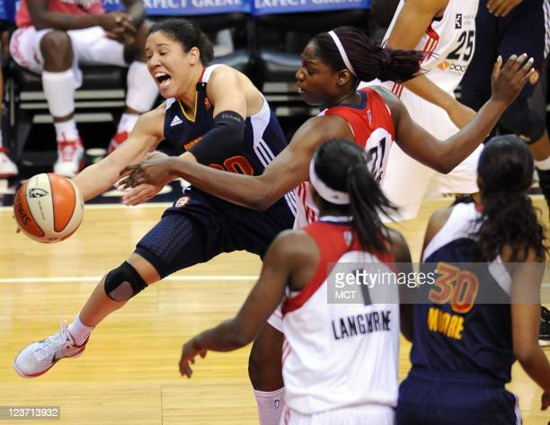 Connecticut Sun guard Kara Lawson gets fouled on a drive to the basket by Washington Mystics center Nicky Anosike during the third quarter at the...