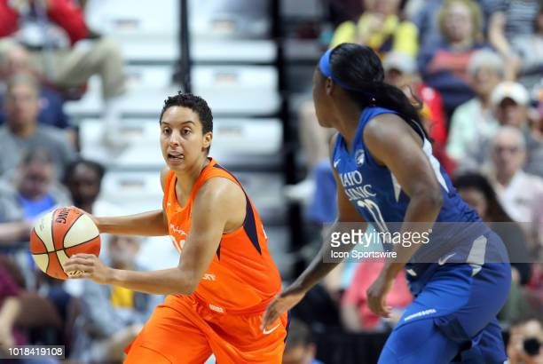 Connecticut Sun guard Layshia Clarendon fast breaks while defended by Minnesota Lynx guard Alexis Jones during a WNBA game between Minnesota Lynx and...