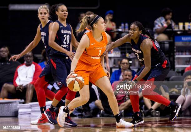 Connecticut Sun guard Rachel Banham dribbles up to Washington Mystics guard Ariel Atkins during a WNBA game between the Washington Mystics and the...