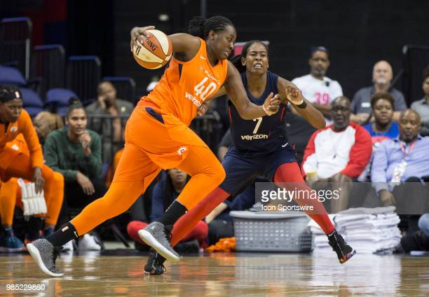 Connecticut Sun guard Shekinna Stricklen charges past Washington Mystics guard Ariel Atkins during a WNBA game between the Washington Mystics and the...