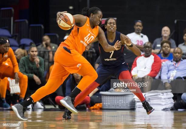 Connecticut Sun guard Shekinna Stricklen charges past Washington Mystics guard Ariel Atkins during a WNBA game between the Washington Mystics and the...