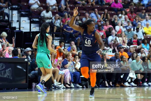Connecticut Sun guard Shekinna Stricklen reacts after making a three point jump shot during a WNBA game between New York Liberty and Connecticut Sun...