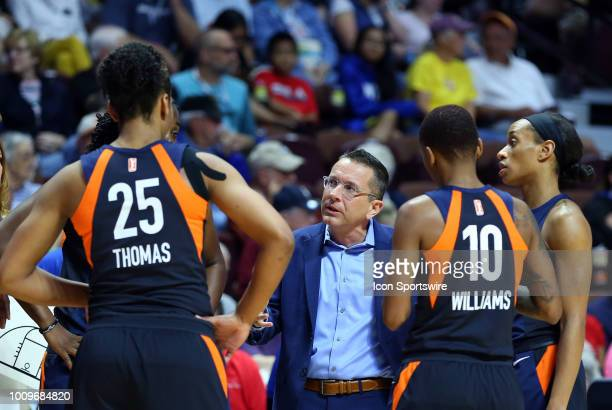 Connecticut Sun head coach Curt Miller speaks with his team during a WNBA game between New York Liberty and Connecticut Sun on August 1 at Mohegan...