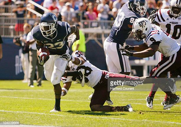 Connecticut tailback Jordan Todman eludes Texas Southern safety Zack Gallow and Curtis Thomas for one of his three touchdowns on the day at...