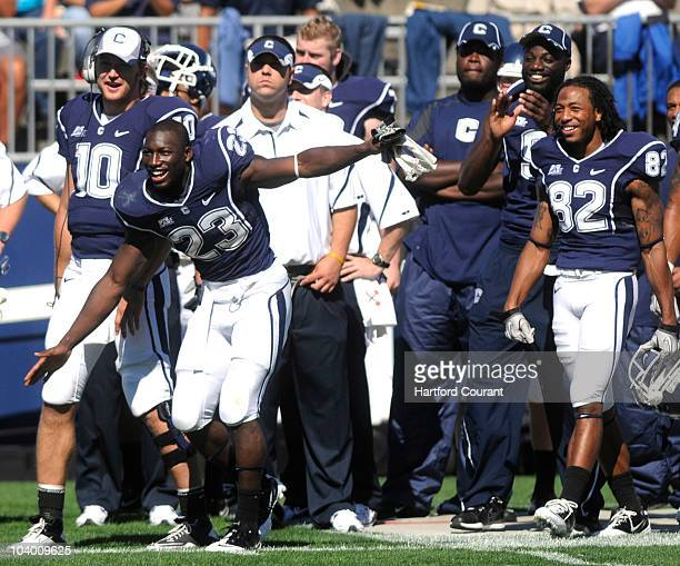 Connecticut tailback Jordan Todman leads a late fourthquarter celebration on the bench In the first half Todman scored three touchdowns against Texas...