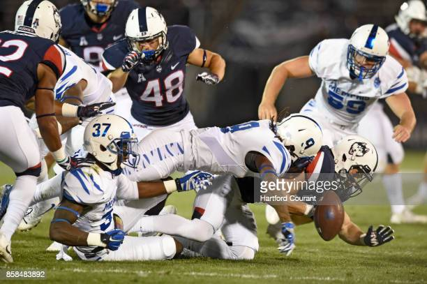 Connecticut wide receiver Kyle Buss fumbles a kickoff return as Memphis defensive back Jamil Collins makes the hit during the third quarter at Pratt...
