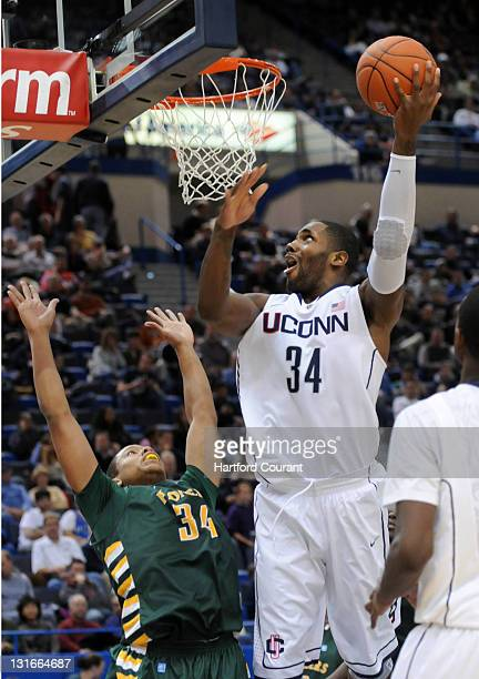 Connecticut's Alex Oriakhi shoots over CW Post's Charles McCann in the second half of their exhibition at the XL Center in Hartford Connecticut...