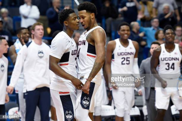Connecticut's Alterique Gilbert and Jalen Adams can feel the tide turning against Stony Brook during the second half at the XL Center in Hartford...