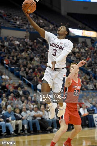 Connecticut's Alterique Gilbert drives past Stony Brook's Bryan Sekunda during the first half at the XL Center in Hartford Conn on Tuesday Nov 14...