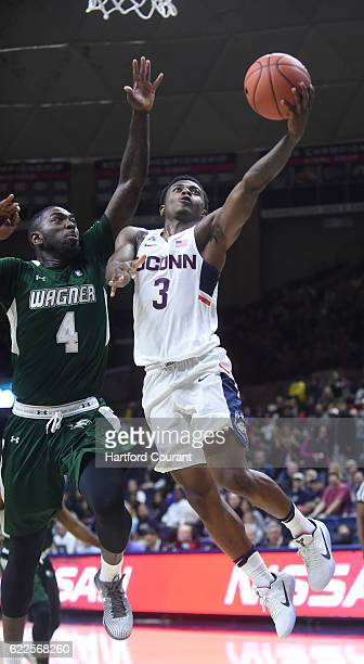 Connecticut's Alterique Gilbert drives to the basket against Wagner's AJ Sumbry at Gampel Pavilion in Storrs Conn on Friday Nov 11 2016 Wagner won...