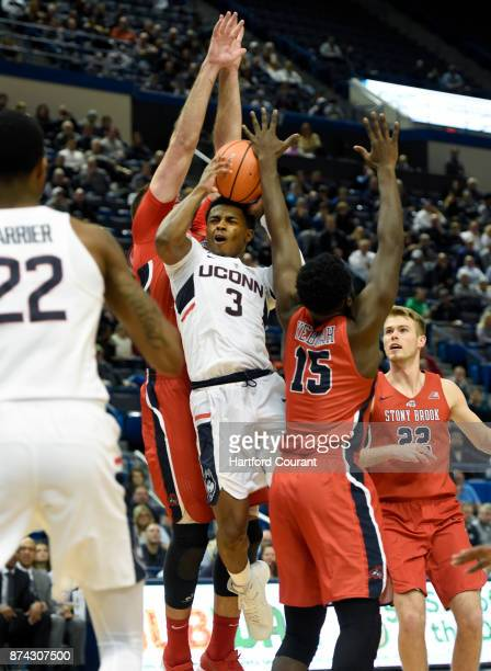 Connecticut's Alterique Gilbert finds a crowd of Stony Brook defenders players in the lane as he drives to the hoop during the second half at the XL...