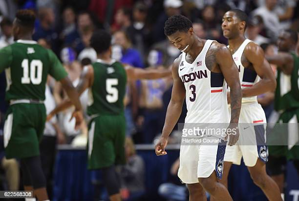 Connecticut's Alterique Gilbert leaves the floor after a seasonopening 6758 defeat against Wagner at Gampel Pavilion in Storrs Conn on Friday Nov 11...