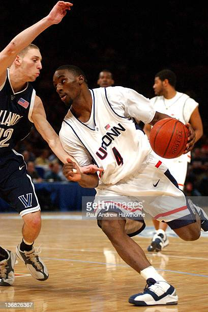 Connecticut's Ben Gordon drives the lane on Villanova's Mike Nardi during first half action at Madison Square Garden in New York City March 12 during...