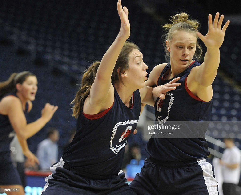 Connecticut's Breanna Stewart, left, and Heather Buck battle for position during a practice session for the next round of the NCAA Women's Basketball Tournament at the Webster Bank Arena at Harbor Yard in Bridgeport, Connecticut, Friday, March 29, 2013. The UConn women face Maryland in the Sweet 16.