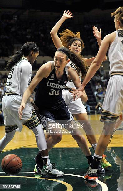 Connecticut's Breanna Stewart tries to grab a loose ball between South Florida's Courtney Williams and Paige Cashin at the USF Sun Dome in Tampa Fla...