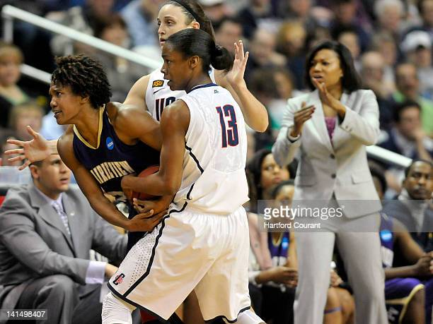 Connecticut's Brianna Banks and Kelly Faris trap Prairie View AM's Latia Williams along the sidelines causing head coach Toyelle Wilson to call a...