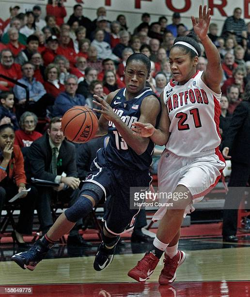 Connecticut's Brianna Banks drives against Hartford's Shanise Bultron during the first half at the Chase Family Arena in West Hartford Connecticut on...