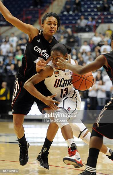 Connecticut's Brianna Banks drives to the basket around Cincinnati's Alyesha Lovett in the second half at Gampel Pavilion in Storrs Connecticut on...