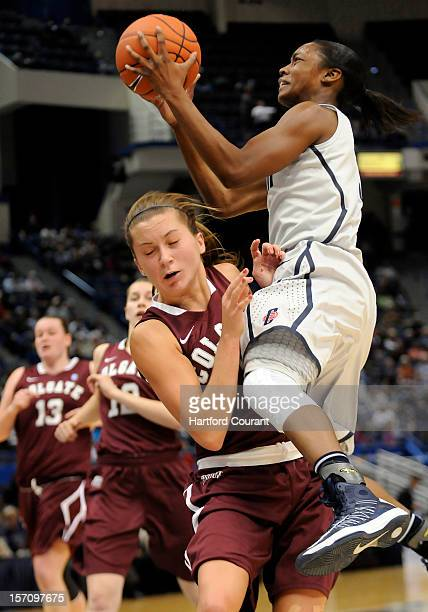 Connecticut's Brianna Banks right drives to the hoop and draws the foul on Colgate's Lauryn Kobiela during the first half at the XL Center in...