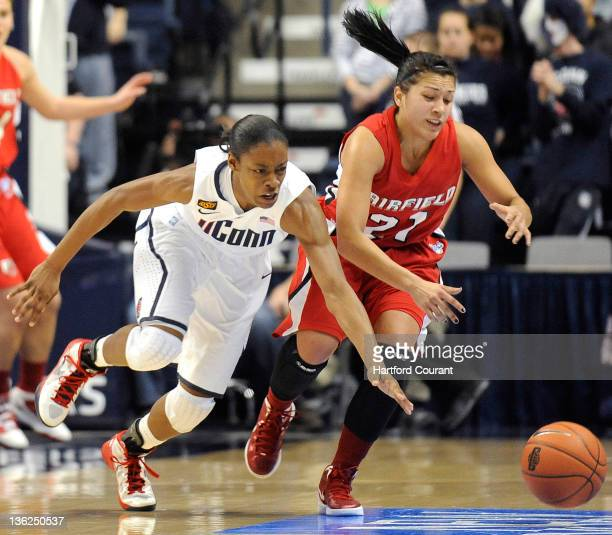 Connecticut's Brianna Banks steals the ball from Fairfield's Desiree Pina right on Thursday December 29 at Gampel Pavillion in Storrs Connecticut...