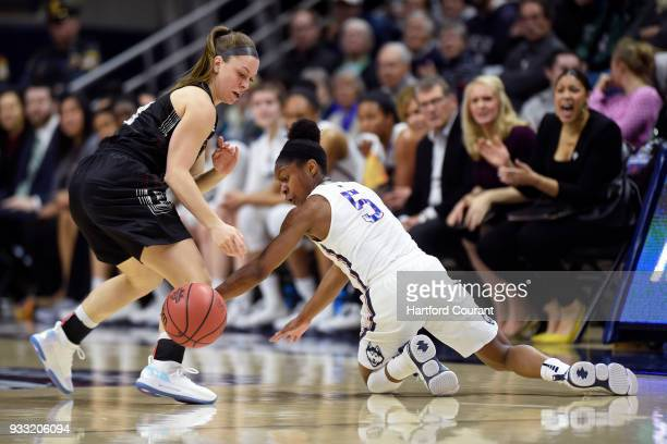 Connecticut's Crystal Dangerfield tries to steal the ball from St Francis' Karson Swogger in the first round of the NCAA Tournament at Gampel...