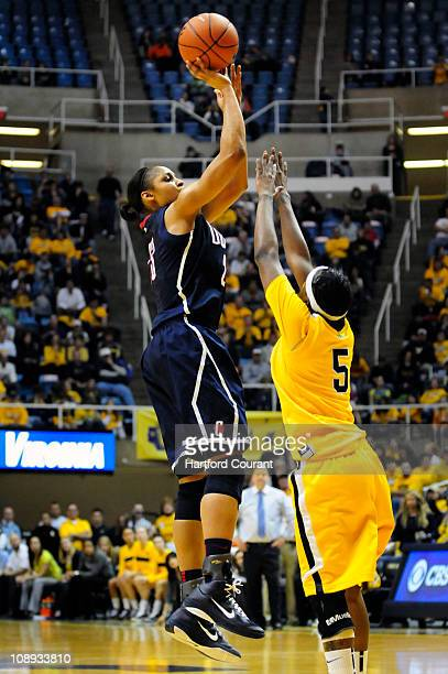 Connecticut's Maya Moore, left, shoots two of her 27 points over West Virginia's Sarah Miles in the second half at the WVU Coliseum in Morgantown,...