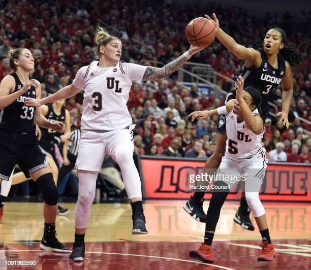 Connecticut's Megan Walker reaches over Louisville's Asia Durr for a loose ball at KFC Yum Center in Louisville Ky on Thursday Jan 31 2019 Louisville...