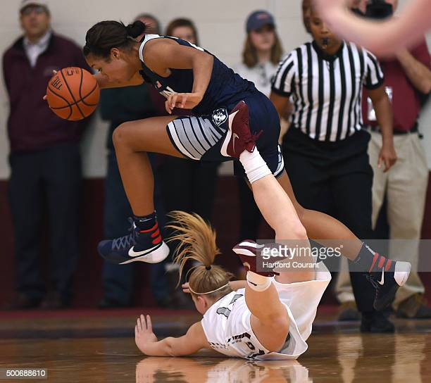 Connecticut's Napheesa Collier leaps over Colgate's Ariel Etheridge after gathering a loose ball at Reid Athletic Center in Hamilton NY on Wednesday...