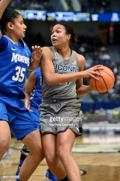 Connecticut's Napheesa Collier right looks for a teammate to pass to as she is defended by Memphis' Jasmine James during the first half at the XL...