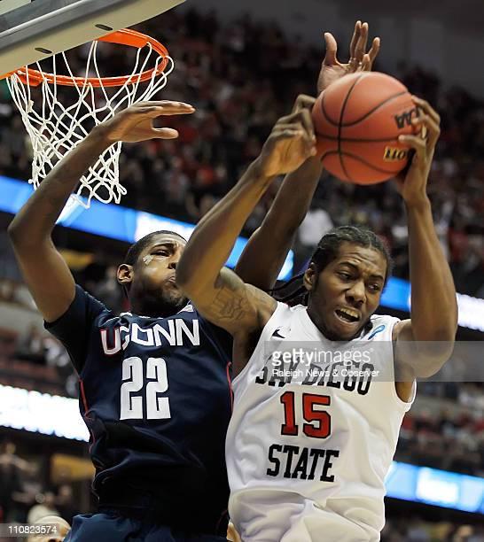 Connecticut's Roscoe Smith battles San Diego State's Kawhi Leonard for a first half rebound at the Honda Center in Anaheim California on Thursday...