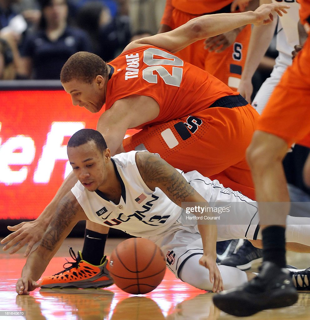 Connecticut's Shabazz Napier (13) battles with Syracuse's Brandon Triche (20) for a lose ball during the second half on Wednesday, February 13, 2013, at the XL Center in Hartford, Connecticut. UConn defeated Syracuse, 66-58.