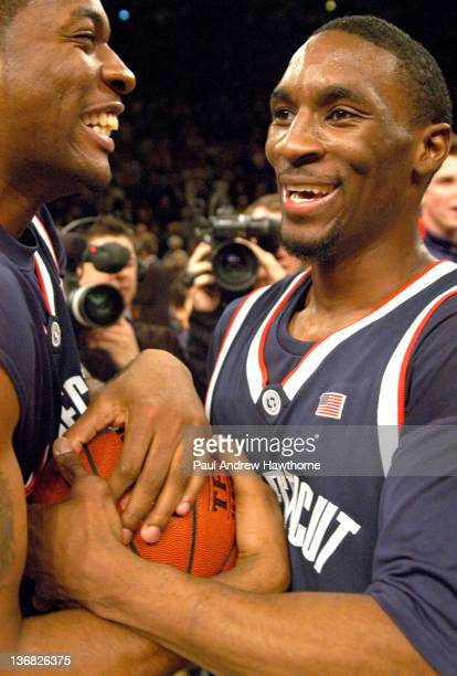 Connecticut's Shamen Tooles left and Ben Gordon celebrate the Huskies win over Pittsburgh at Madison Square Garden in New York City March 13 during...