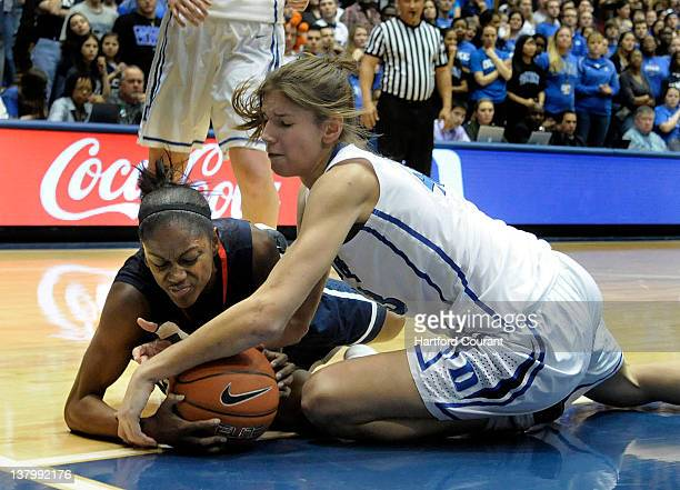 Connecticut's Tiffany Hayes left scrambles for a loose ball against Duke's Allison Vernerey in the first half at Cameron Indoor Stadium in Durham...