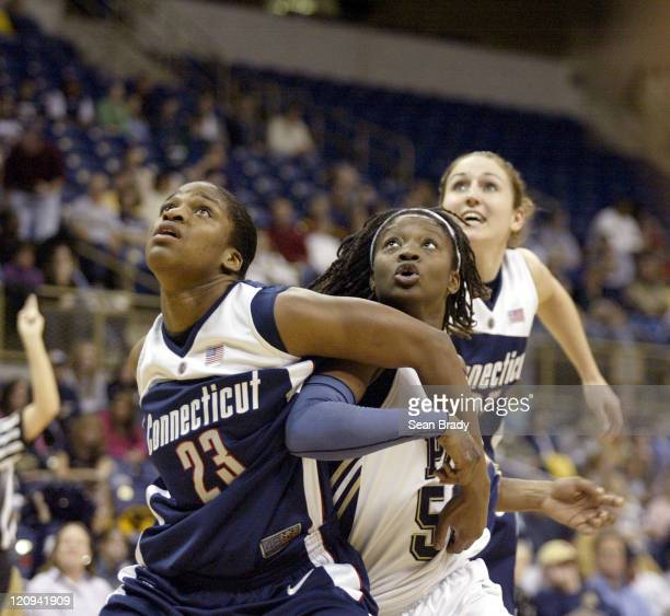 Connecticut's Willnet Crockett gains position on Pittsburgh's Cheron Taylor at the Petersen Events Center on January 21 2006 in Pittsburgh...