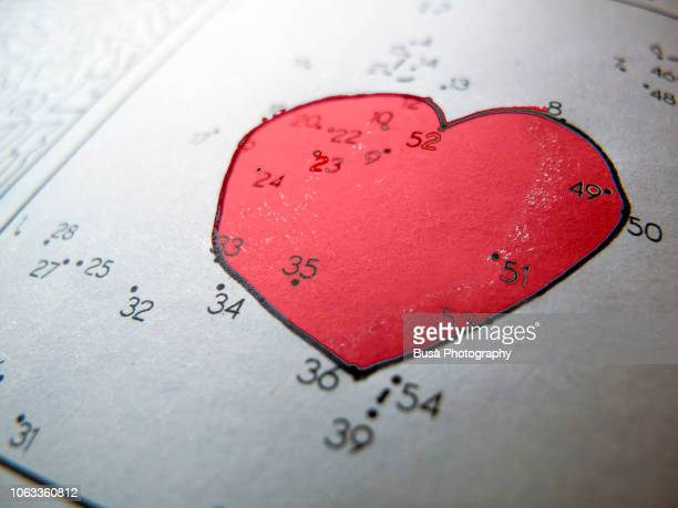 connecting the dots leisure game with heart shape - connect the dots stock pictures, royalty-free photos & images
