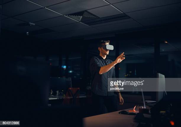 connecting to infinite opportunities - virtual reality simulator stock photos and pictures