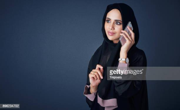 connecting with people who matter - muslim woman darkness stock photos and pictures