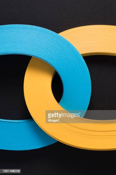 connection of multi-layer paper stripes - link chain part stock photos and pictures