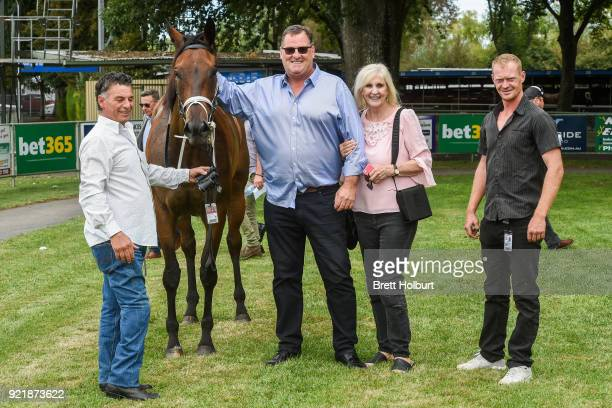 Connections of Borrow after winning the Iron Jack FM Maiden Plate at Kyneton Racecourse on February 21 2018 in Kyneton Australia