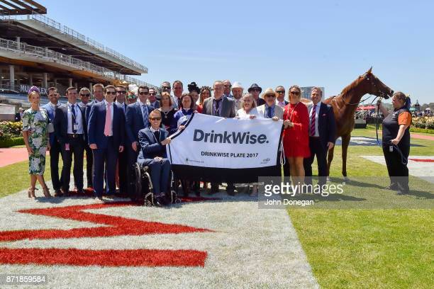 Connections of Linguist after winning the DrinkWise Plate at Flemington Racecourse on November 09 2017 in Flemington Australia