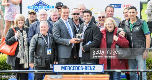 Connections of Moss 'n' Dale pose with the trophy after winning the Mercedes Benz Handicap at Warrnambool Racecourse on May 04 2017 in Warrnambool...