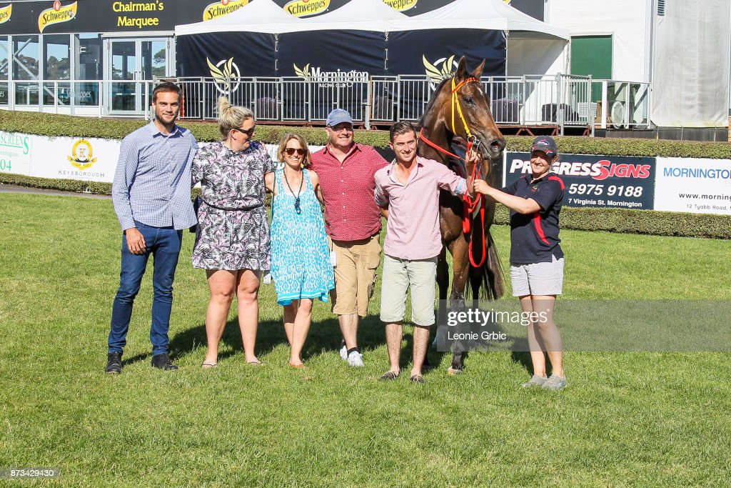 Connections pose with Aurora Miss after winning the Mornington Car & Tyre Services Handicap at Mornington Racecourse on November 13, 2017 in Mornington, Australia.