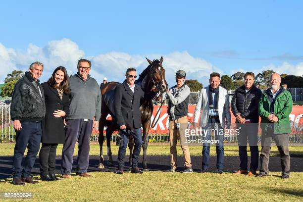 Connections pose with Diamond Grace and trainer Michael Kent after winning the Spicer Thoroughbreds Handicap at Ladbrokes Park Hillside Racecourse on...